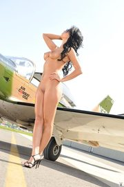 Playboy Beauty Melissa Riso Exposing Her Sexy Curves On The Plane