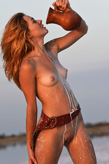 Kaleesy Takes Milky Shower On The Beach