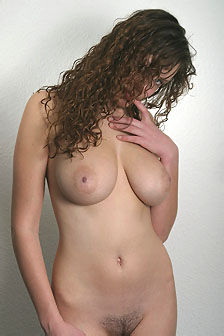 Busty Natural Beauty Gets Nude In Studio